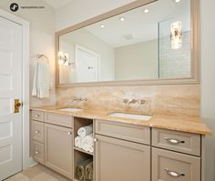 Vanity and backsplash add drama in this beautiful bathroom.