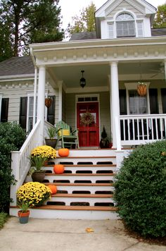 Red Front Door Brown House tan house red door |  brown with black shutters which showcases