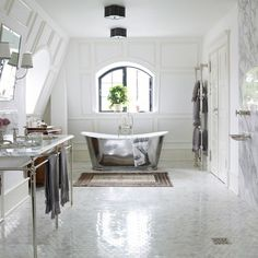 Marianne Brandi of Day Birger et Mikkelsen, has created an indulgent bathroom in her Copenhagen home - complete with wet room-style shower and freestanding bath.