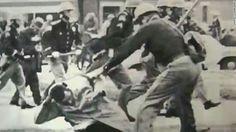 John Lewis being beaten by police.