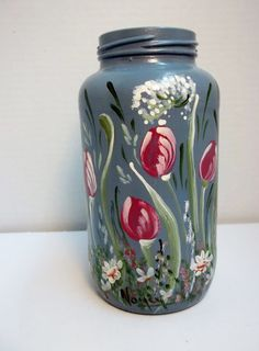 Items similar to SALE***A Glass Jar Painted Blue Hand Painted Original Design Folk Art, My Garden Style on Etsy Painted Jars, Hand Painted, Glass Jars, Mason Jars, Tulips Garden, Altered Bottles, Grasses, Garden Styles, Daisies