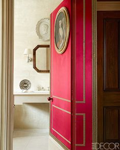 Alidad's London Apartment - Bathroom with hallway door lined in suede and braid work | ELLE DECOR #bathroom #red #hallway