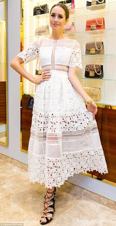 Stylish: On Thursday, British TV star and style maven Louise Roe stepped out looking ultra-glamorous at her book launch at Bondi Westfield, wearing a white lace dress