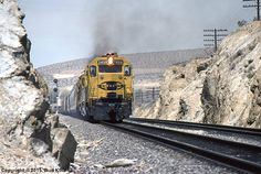 ATSF #3456 (EMD GP35) storms towards Victorville from Oro Grande, CA on April 03, 1982.   Photo by Bud Kula.