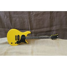 "Yellow and Black ""Bumble Bee "" Gloss Finish Lightweight Basswood Body Set Neck Hard Rock Maple Neck African Blackwood Fret Board 50s Profile Neck Jin-Ho Stamped Tuners BYO Hurricane P-90 8.3k GB-WRAP Black Chrome Wrap Around Bridge Hand Made Bone Nut Switchcraft Output Jack All Braided Wiring Sheilded Pickup and Control Cavity Low Action With D Addario 10s D Addario Eliptical Strap Buttons All Black Hardware and Screws QA Bumble Bee Logo on Back of Neck"