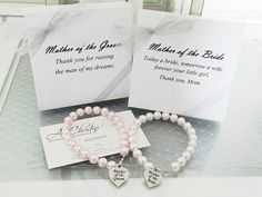 Great idea Etsy listing at https://www.etsy.com/listing/158872978/mother-of-the-bride-pearl-strand