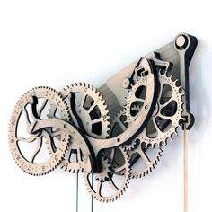 Moonlight as a master horologist by crafting your very own clock with the Abong wooden clock. It features meticulously designed, laser cut pieces for easy assembly, no special tools or skills required. The graceful pendulum is accented by bronze w. Wooden Clock, Wooden Decor, Wooden Diy, Hobbit Hole, The Hobbit, Bronze Wheels, Mechanical Clock, Stuff To Do, Cool Stuff