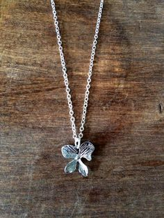 """Silver plated orchid flower pendant on lightweight silver plated chain - 17"""" #simpleLine #silver #orchid #flower #jewelry #short #wearUniquely www.doxahlogy.com"""