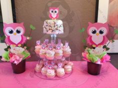 Pink owl cupcakes display