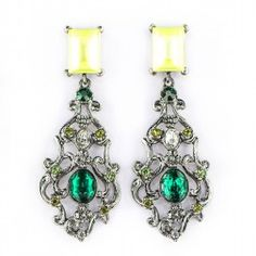 Sparkling with green and fluorescent crystals. Show it off against a simple gray sweater, and pick out your favorite color with a bright skirt. Green and fluorescent crystals earrings.