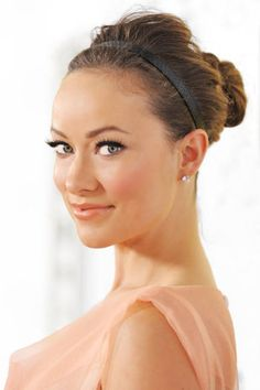 Just a simple black headband can make your hair work-ready. Teasing the hair behind the headband not only adds volume, it will help prevent the band from slipping.