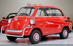 1959 BMW Isetta 600 in Japan Red over Gray and Red Interior. This car was built for the U. market, with the front and rear nerf bars as well as sealed-beam headlights. Sealed Beam Headlights, Bmw Isetta, Miniature Cars, Fiat 600, Red Interiors, Small Cars, Cool Suits, Classic Cars, Restoration