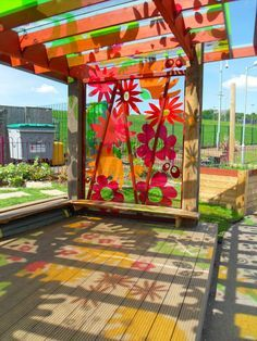 pergola with acrylic panels - I love the colored shadows