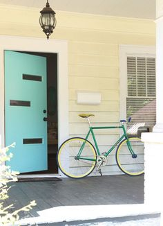 Love the midcentury modern turquoise front door // Paint colors that match this Apartment Therapy photo: SW 0075 Holiday Turquoise, SW 7757 High Reflective White, SW 6235 Foggy Day, SW 6148 Wool Skein, SW 6393 Convivial Yellow House, Paint Colors For Home, House Exterior, Yellow House Exterior, Front Door, Garage Door Design, Craftsman House, Doors, Door Color