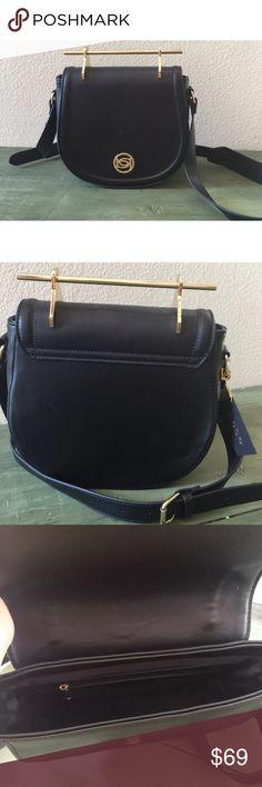 bebe black and gold lily saddle crossbody purse Brand new with $99 tags. Gold bar at the top. Magnetic closure. Adjustable crossbody strap. Zippered pouch on the inside with an additional compartment. Even nicer in person. Sleek and practical! 9x10x3.5. Shown in blue in the last picture to give you an idea of what it looks like on. bebe Bags Crossbody Bags