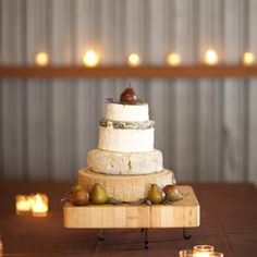 Wheels of cheese tiered wedding cake. AWESOME!