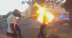 Police officers shot a man with a tear gas canister and then lit it on fire with a taser which caused him to burst into flames.