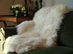 Blankets are required in the lounge. This natural sheepskin blanket looks ultra cozy.