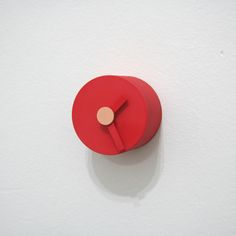 'solids wall clock' designed by daniel to and emma aiston