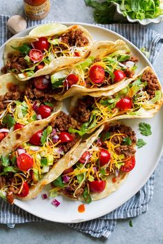 These Ground Beef Tacos are made with a deliciously seasoned ground beef filling, served in corn tortillas and finished with all the best toppings. Mexican Food Recipes, Beef Recipes, Cooking Recipes, Ethnic Recipes, Ham And Beans, Ham And Bean Soup, Quesadillas, Churros, Empanadas