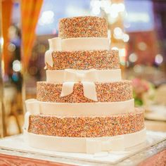 Colorful Sprinkles Topped Wedding Cake // Stephanie Hunter Photography // Confections In Cake // http://www.theknot.com/weddings/album/an-elegant-traditional-wedding-in-fort-worth-tx-139760