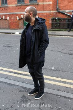 Men's street style, when black on black is too much, opt for navy. Wear a navy parka over a suave navy crew neck jumper and add a pair of suede shoes | Shop men's shoes and clothes at The Idle Man