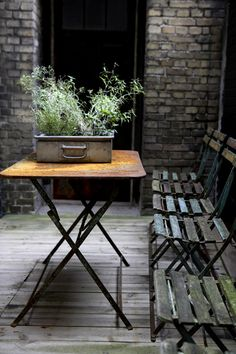 Love the garden chairs, metal table, brick, and plants.  The mini-garden!