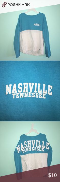 Nashville Shirt Pom pom jersey, blue & white, worn once, like-new condition, size S but fits like an XS--If you love Nashville or you've visited before, this would be the perfect addition to your closet! Tops Tees - Long Sleeve