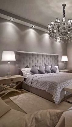Luxury Bedroom design. Luxury chandelier. White table lamp. Silver bed. Modern master bedroom decor ideas. For more inspirational ideas take a look at: www.bocadolobo.com