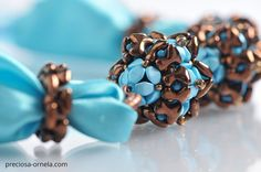 """Design: Ivona Suchmannova  PRECIOSA ORNELA presents the new PRECIOSA Tee™ pressed bead from the PRECIOSA Traditional Czech Beads™ brand. Its dimensions of 2 x 8 mm conform to the current trend in mini-beads. The axially symmetrical flat shape of the letter """"T"""" enables the application of vacuum half-coatings on both sides of the bead with the resulting effect of an allover coating and other popular surface coatings. The strung beads closely interlock and create an interesting zip effect. It…"""