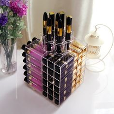 32 Holy Grail Organization Products To Make Your Life Easier A rotating organizer to help you wear more of the lippies you already own. 32 Holy Grail Organization Products To Make Your Life Easier Lipstick Organizer, Lipstick Holder, Cosmetic Storage, Makeup Storage, Lipgloss, Red Lipsticks, Blue Lipstick, Pantone, Magnetic Makeup Board