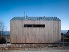 """Family House in Lety / studio pha. The extremely simple and formally """"traditionalist"""" appearance of the house's mass is the result of the somewhat strict local building regulations regarding the shape and pitch of the roof, the height (number of floors) of construction, and distance from the edges of the plot."""