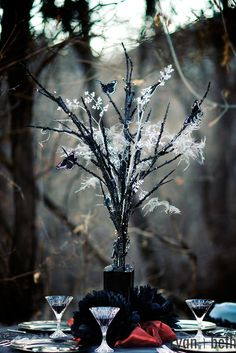 Halloween wedding theme idea  black tree centerpiece with white cobweb and spiders  hint of orange