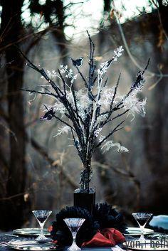 Halloween wedding theme idea  black tree centerpiece with white cobweb and spiders  hint of orange