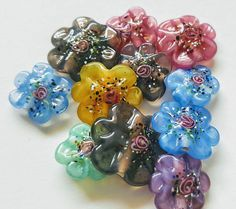 Lampwork Beads Handmade Czech Glass Petal Flower Color Assortment Making Jewelry, Jewellery / ... Just Your Quality Bead Basics & Then Some ... https://www.etsy.com/shop/CatHouseBeads 17mm & 8mm approx., sizes as each handmade flower and petal are unique in shape and size. 11 Handmade Hand Painted Petal Flower Beads 1 Amethyst 1 Yellow 1 Green 2 Pink 3 Blue 3 Black Diamond Although the bead shapes are obvious, there are still subtle variations in each ha...