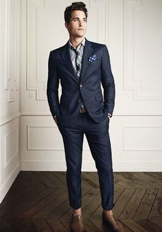 Blue Suit, un-buttoned collar, turned up trousers but still very smart.