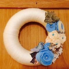 Christmas yarn wreath in white pale blue old gold and silver