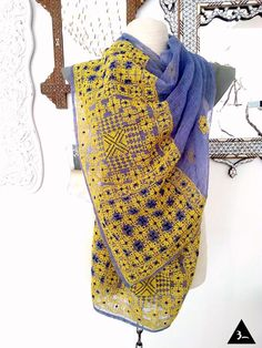 Hand embroidered geometric pattern on a handmade Najafi fabric (camel hair, particularly collected from the camel hump). A one‐of‐a‐kind scarf.