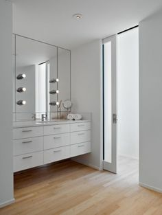 Love this vanity and the glass pocket door
