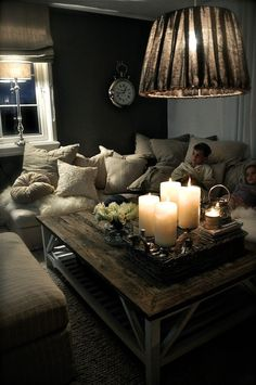 .Love all the pillows and the rustic table. Another room for my log cabin. Lol
