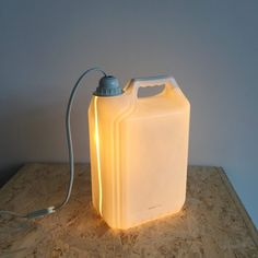 Original Plastic Bottle Lamps Made from a used plastic wash powder bottle. I made a hole in the bottom to place the lamp. Diy Bottle Lamp, Recycled Lamp, Recycled Art Projects, Oil Lamps, Cool Lighting, Lamp Design, Plastic Bottles, Lamp Light, Recycling