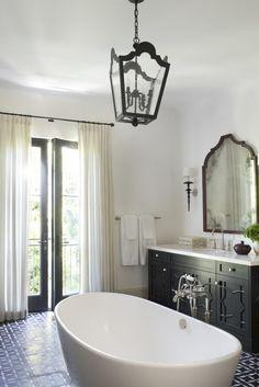 A Moroccan-Inspired Home in Los Angeles | Interior Design by Betsy Burnham of Burnham Design | Photography by Sarah Dorio | Modern Sanctuary | Bathroom | Powder Room | Global Bathroom | Tiles | Flooring | Lighting | Bath Fixtures | Mirror