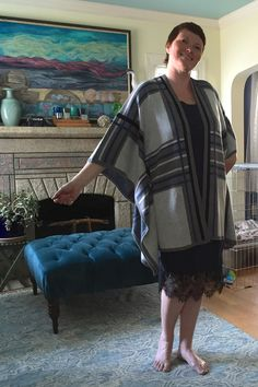 My second Stitch Fix (August 2015): I loved the Maliya Poncho Cardigan in blue, grey, and black plaid. I liked how the lace hem on the slip dress peeped out from below the blanket cardigan, but it did not hang well on my body and was not flattering. Plus I just don't do spaghetti straps. Sent it back. Bought another dress to wear with the cardigan.