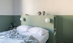 After an explosion severely damaged the Klinker family's newly-bought Barcelona holiday apartment, architecture studio CaSA was commissioned to salvage its original art nouveau elements while reinventing on a budget. Architectural Digest, Decor, Apartment, Built In Furniture, Barcelona Apartment, Home, Interior, Mint Walls, Modern Bedroom