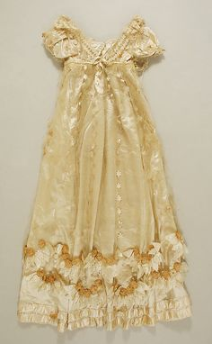 c. 1814 evening dress (back), French, made of silk The Metropolitan Museum of Art 11.60.216a, b - this dress has stunning decorations!