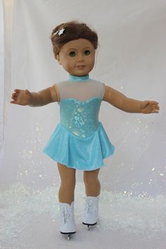 """MissyCrissy2 made this sparkling Elsa from Frozen inspired skating dress for American Girl dolls using Lee & Pearl's Pattern #1055: Skating Dresses for 18"""" Dolls and the Lee & Pearl Ice Princess Fabric Kit. To make your own, get the pattern and fabric kit in our Etsy store at https://www.etsy.com/shop/leeandpearl"""
