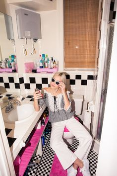 "Inside Artist and Model Carlotta Kohl's Closet: ""I really want plaid pants, and I'm looking for wool trousers in reds and then, like, a pretty heather-gray. Anything gingham."" Black and White Lace Gingham Top, Vintage; White Jeans, Eve Denim 