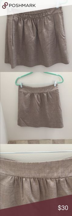 J. Crew tan/beige pleated mini skirt Awesome skirt! In a great neutral color to wear all year long. Great with tights for fall/winter. J. Crew Skirts Mini