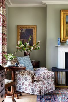 Armchair by the fireplace in Vanessa Macdonald& sitting room in the Oxfordshire countryside. The patterned rug and curtains pick up the colours from the chair, while sage green walls create a calming effect. Living Room Green, My Living Room, Home And Living, Living Room Decor, Modern Living, Sage Green Walls, Mint Walls, Georgian Homes, Cottage Interiors