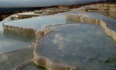 Pamukkale-Turkey. The site consists of hot springs, and the terraces are made of traventine or sedimentary rock that gets accumulated by the water produced by hot springs. Beautiful Places In The World, Places Around The World, Beautiful Places To Visit, The Places Youll Go, Places To Go, Most Beautiful, Wonderful Places, Amazing Places, World Heritage Sites